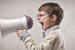 Magento Shopify Developer UK Berkshire Surrey Hampshire ERP Systems Integrator Image Kid screaming through Megaphone